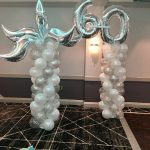 silver/white balloon columns with toppers