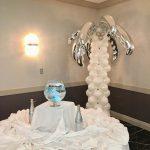 white on white table and balloon column