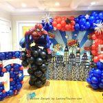organic garland backdrop with custom cityscape floor props